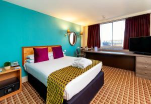 A bed or beds in a room at Copthorne Tara Hotel London Kensington