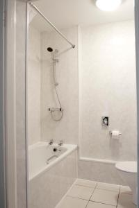 A bathroom at The Regency Hotel; Sure Hotel Collection by Best Western