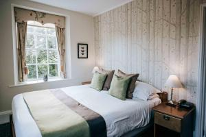 A bed or beds in a room at Flackley Ash Hotel Restaurant & Spa
