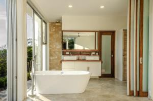 A bathroom at Modern Beach House with Stunning Views - Sleeps 4