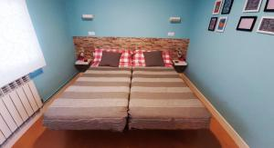 A bed or beds in a room at Apartamento Talako