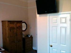 A television and/or entertainment center at Clifton Hotel