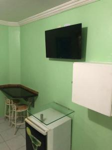A television and/or entertainment centre at Hotel Sucess Adult Only