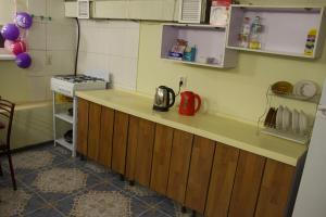 A kitchen or kitchenette at Аморе2