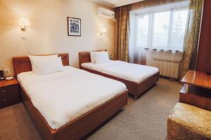 Кровать или кровати в номере Улан-Удэ Парк Отель