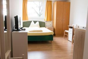 Ein Bett oder Betten in einem Zimmer der Unterkunft Wohnen in Innsbruck