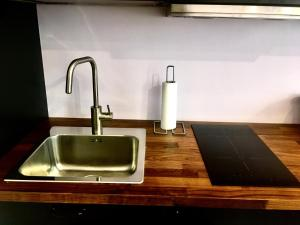 A kitchen or kitchenette at Rooms Boutique Carducci