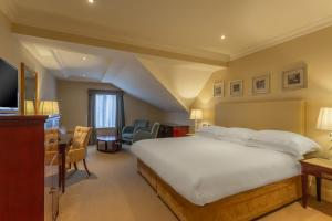 A bed or beds in a room at Bunratty Castle Hotel, BW Signature Collection
