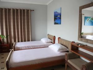 Ein Bett oder Betten in einem Zimmer der Unterkunft Relax Apartments Ksamil
