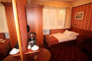 A bed or beds in a room at Old Prague Hotel