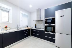 Una cocina o zona de cocina en Genteel Home Maestranza