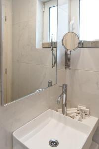 A bathroom at Athens Cypria Hotel