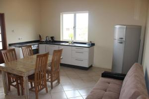 A cozinha ou cozinha compacta de KUNUKU-ABOU APARTMENTS CURAÇAO (A)