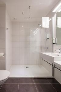 Een badkamer bij Mezzo Hotel & Business