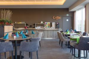 Een restaurant of ander eetgelegenheid bij Mezzo Hotel & Business