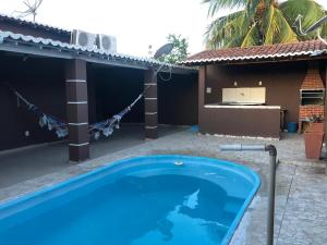 The swimming pool at or close to Propriedade do Marcio