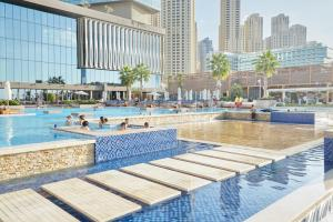 The swimming pool at or near Sonder — JBR Suites