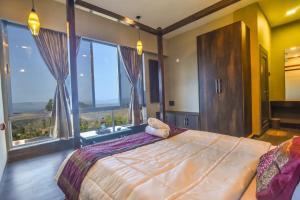 A bed or beds in a room at Meraki Villa