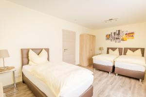 Ein Bett oder Betten in einem Zimmer der Unterkunft Boardinghaus Modern Living