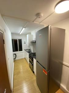 A kitchen or kitchenette at Lovely Modern Triple Shared Room Central Location