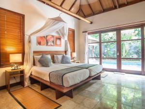 A bed or beds in a room at Mango Tree Villas