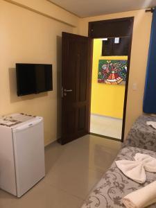 Uma TV ou centro de entretenimento em Villa Simone