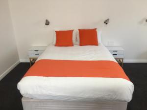 A bed or beds in a room at Sturt Motel