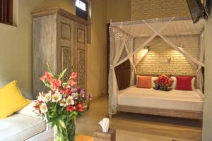 A bed or beds in a room at Urban Bliss Studio
