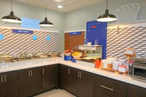 A kitchen or kitchenette at Holiday Inn Express Hotel and Suites South Padre Island