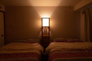 A bed or beds in a room at Coatheim Yokohama 502 / Vacation STAY 2367