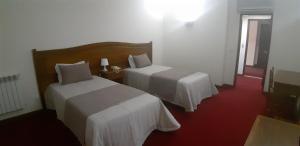 Uma cama ou camas num quarto em Hotel Santa Maria