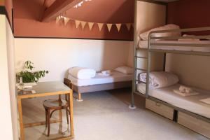 A bunk bed or bunk beds in a room at HO36 Avignon