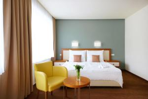 A bed or beds in a room at Hotel Radun