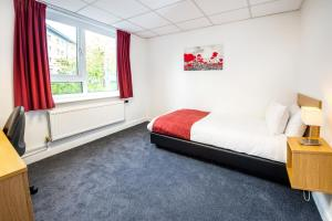 A bed or beds in a room at Lancaster University