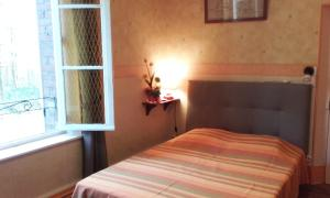 Un ou plusieurs lits dans un hébergement de l'établissement Bernafay Wood B&B
