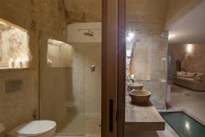 Un baño de L'Hotel In Pietra