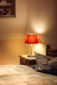Ein Bett oder Betten in einem Zimmer der Unterkunft Hotel und Restaurant Peking