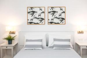 Кровать или кровати в номере RVHotels Sea Club Menorca
