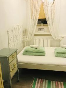 Кровать или кровати в номере Город Патриаршие Хостел