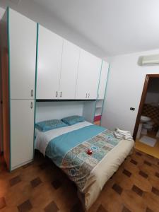 Letto o letti in una camera di Bed & Breakfast Villa Flora