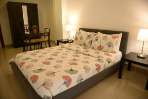 A bed or beds in a room at Mauad Hotel Boutique