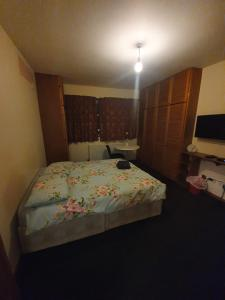 A bed or beds in a room at Double Room in a House