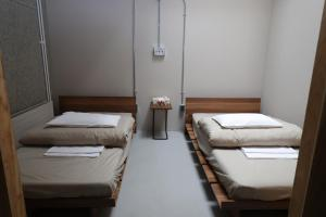 A bed or beds in a room at Guesthouse ushiyado
