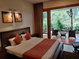 A bed or beds in a room at The Birchwood Retreat, Madikeri