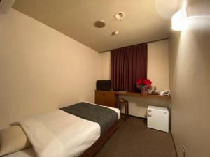 ホテルフリースタイルにあるベッド
