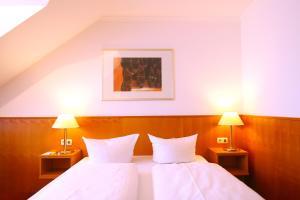Ein Bett oder Betten in einem Zimmer der Unterkunft VinoThek Hotel - BoardingHouse