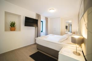 A bed or beds in a room at Apartments Korta