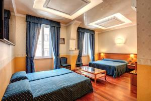 A bed or beds in a room at Hotel Verona Rome