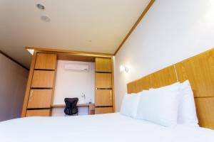 A bed or beds in a room at Landmark Hotel
