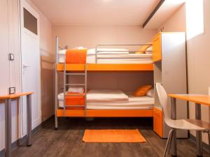 A bunk bed or bunk beds in a room at Botel Marina